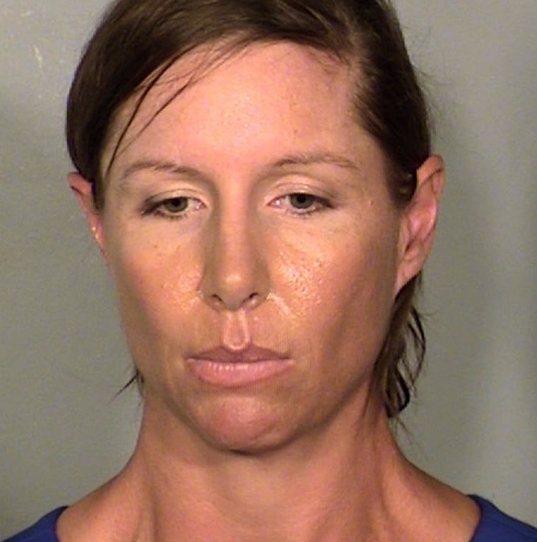 Booking photo of Alison Ernst, who was arrested for throwing a shoe at former Secretary of State Hillary Clinton.