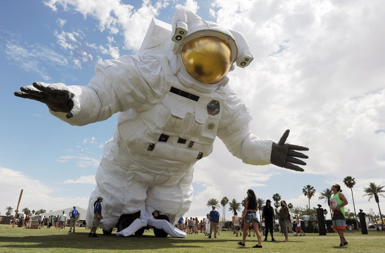 """Image: The \""""Escape Velocity\"""" moving sculpture by artist group Poetic Kinetics looms over Coachella festival-goers on the Empire Polo Field"""