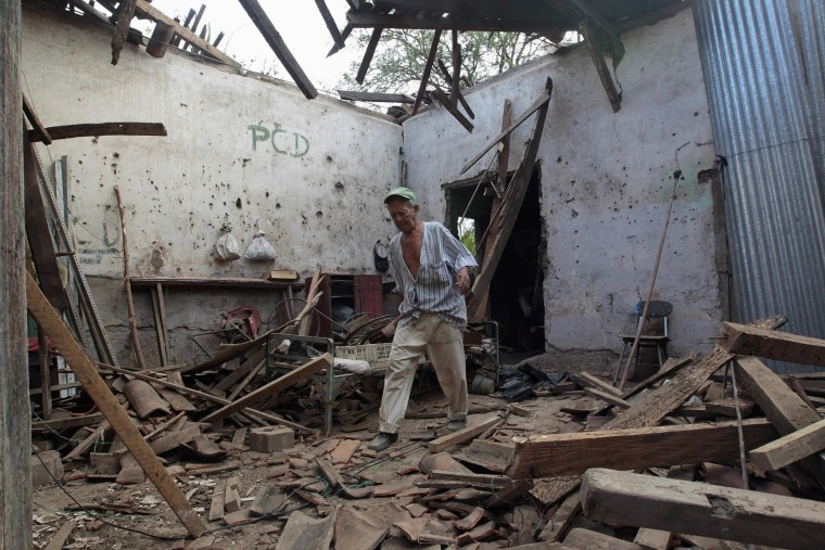 Image: A man walks inside his house damaged by an earthquake of magnitude 6.1 in Nagarote town