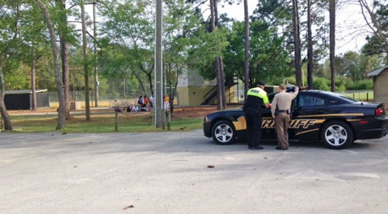 Police respond at the scene where a student at Roland-Grise Middle School died Friday afternoon, after being hit by a line drive during baseball practice.
