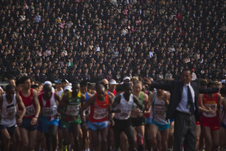 Image: North Korean spectators watch from the stands of Kim Il Sung Stadium as runners line up a the start of the Mangyongdae Prize International Marathon in Pyongyang