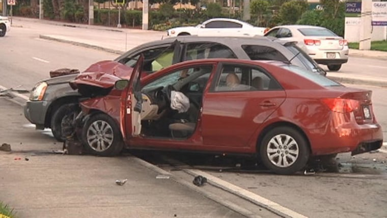 Image: Smashed cars at the scene of a deadly accident.