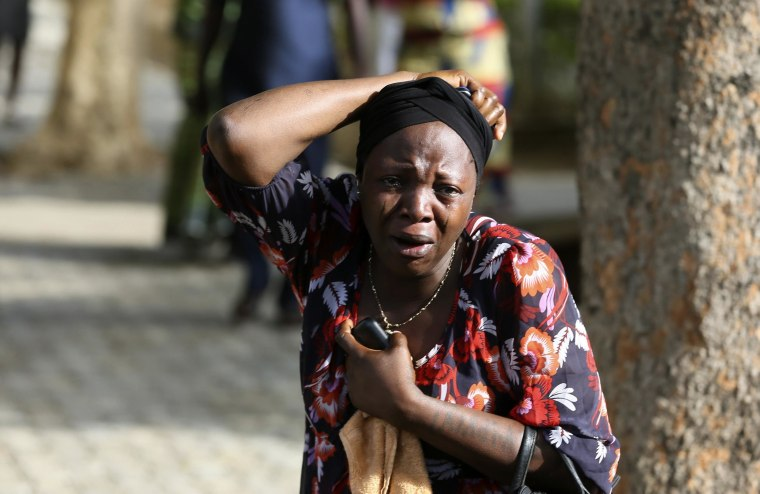 A bystander reacts as victims of a bomb blast arrive at the Asokoro General Hospital in Abuja, Nigeria, on Monday.