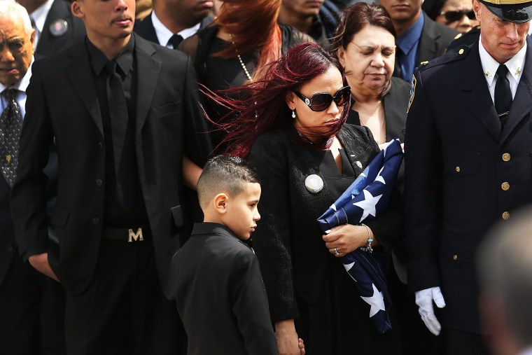 Image: Funeral Held For NYPD Officer Injured While Investigating Fire In High Rise