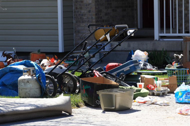 Belongings are shown on the ground in front of the garage where seven infant bodies were discovered and packaged in separate containers at a home in Pleasant Grove, Utah.