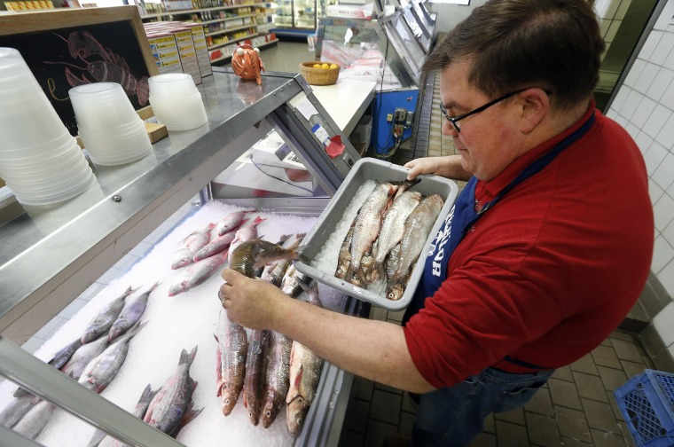 Kevin Dean, co-owner of Superior Fish Company, puts Whitefish out for sale in Royal Oak, Mich., on April 14. Many fish markets in the Great Lakes region are running short of whitefish, and it's coming at a bad time: Passover.