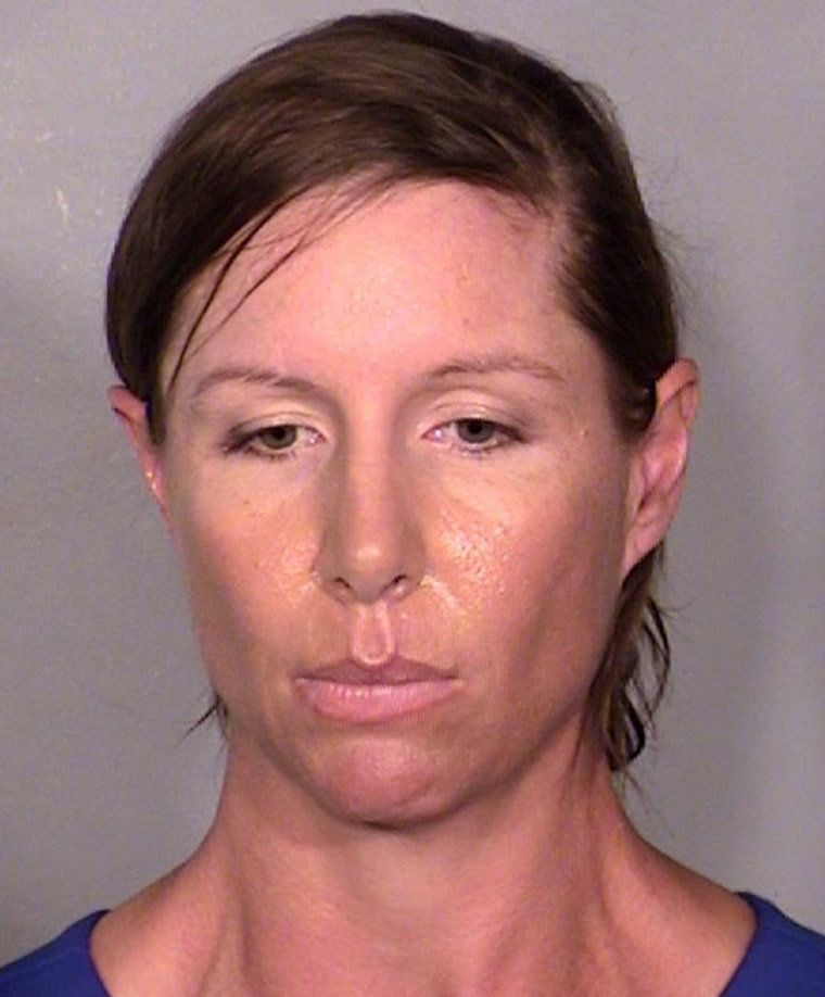 Image: Alison Ernst is seen in a booking photo from the Las Vegas Metropolitan Police Department