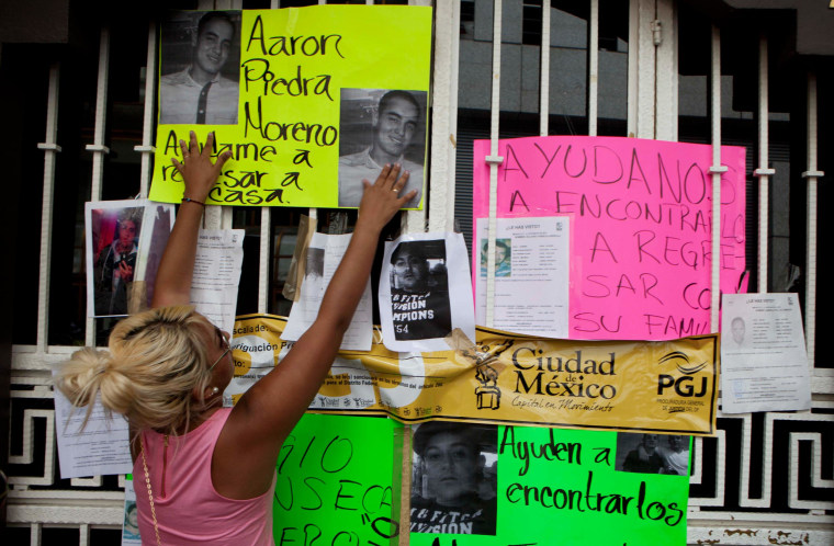 Image: Photos of recently disappeared relatives are posted in Mexico City on May 30, 2013.