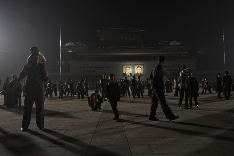 Image: North Koreans gather on Kim Il Sung Square in Pyongyang before a fireworks display to celebrate the official birthday of the late leader Kim Il Sung on Tuesday