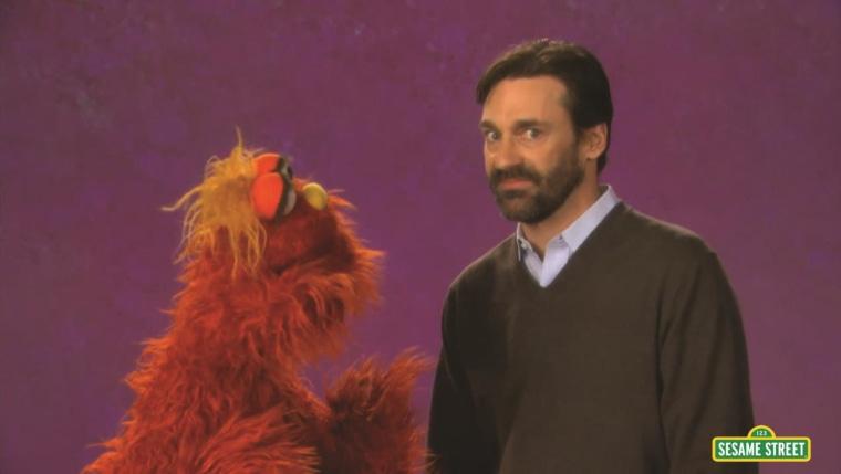 "Jon Hamm with Murray on ""Sesame Street."""