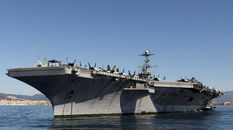 The aircraft carrier USS Harry S. Truman moored in Palma de Mallorca, Majorca, 6 April 2014. One quarter of U.S. tax revenue goes toward the military, according to the annual taxpayer receipt, a breakdown of how those taxes you just paid are being spent.
