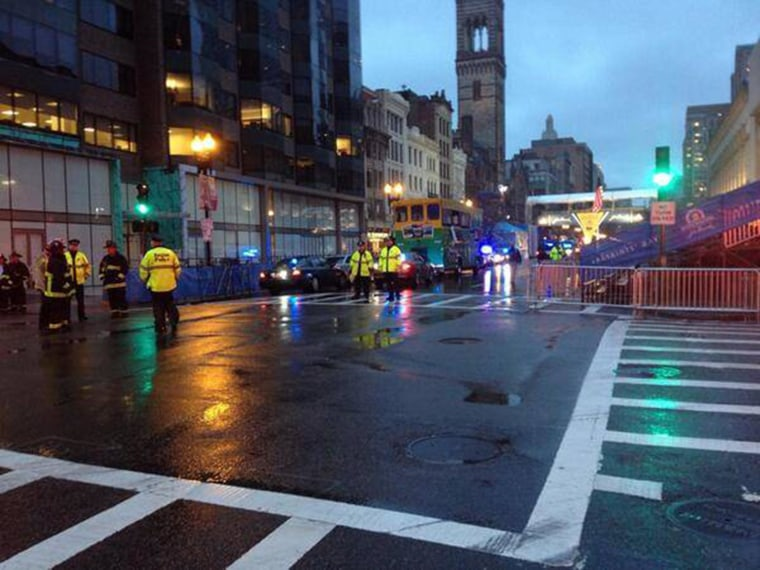 Image: Police stand near the finish line of the Boston Marathon, where unattended backpacks were found on Tuesday