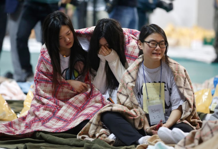 Image: Rescued passengers cry at a gym