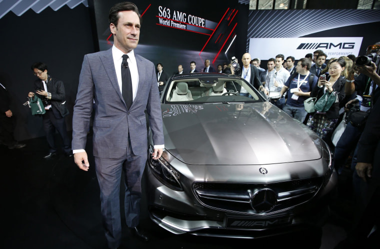 Actor Jon Hamm poses for photographers next to the Mercedes-Benz S63 AMG Coupe after it was unveiled at the New York International Auto Show.