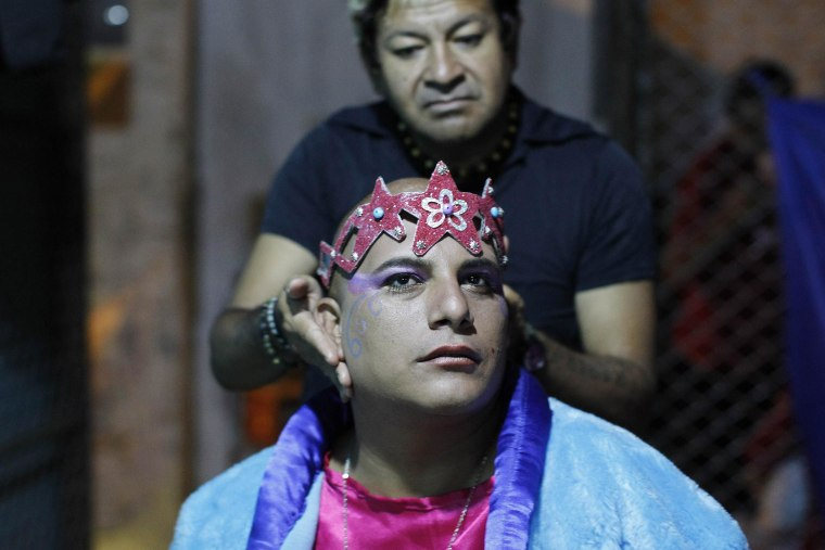 "Image: An inmate receives make up backstage before taking part in the theatre play ""Jesus Christ Superstar"" at Sarita Colonia prison yard in Lima"
