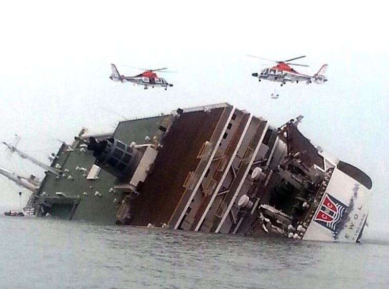Rescue helicopters fly over a sinking South Korean passenger ferry that was carrying more than 450 passengers, mostly high school students, Wednesday, April 16, 2014, off South Korea's southern coast. Hundreds of people are missing despite a frantic, hours-long rescue by dozens of ships and helicopters. At least four people were confirmed dead and 55 injured. (AP Photo/Yonhap) KOREA OUT
