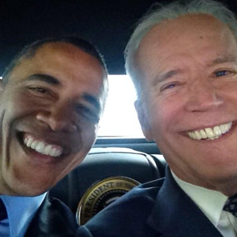 Image: Vice President Joe Biden takes a selfie with President Barack Obama