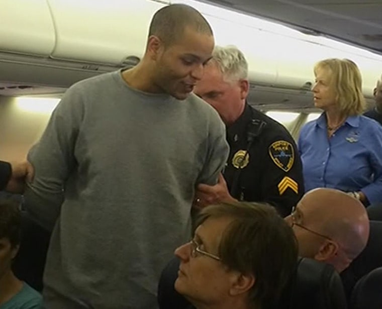 Image: Joshua Suggs is escorted off a Southwest Airlines flight.