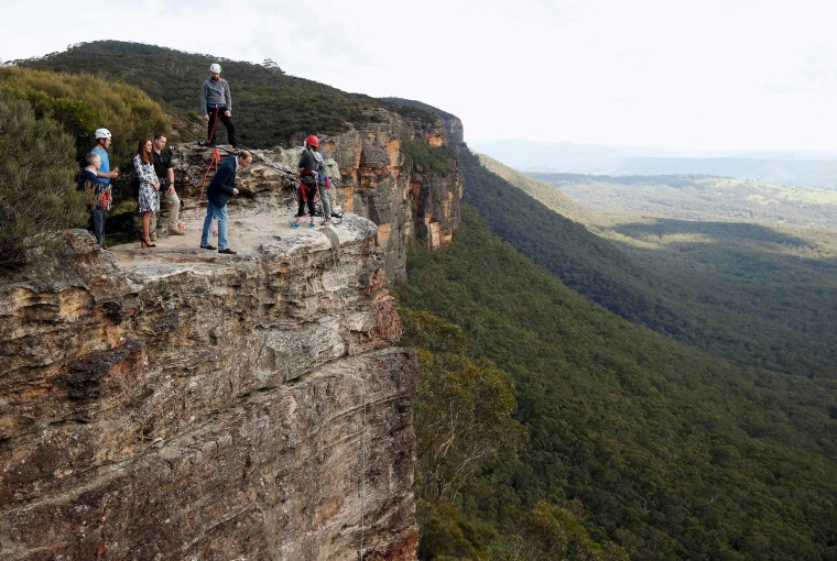 Britain's Prince William looks over the edge of a cliff at Narrow Neck Lookout in the Blue Mountains town of Katoomba, Australia on April 17, 2014.
