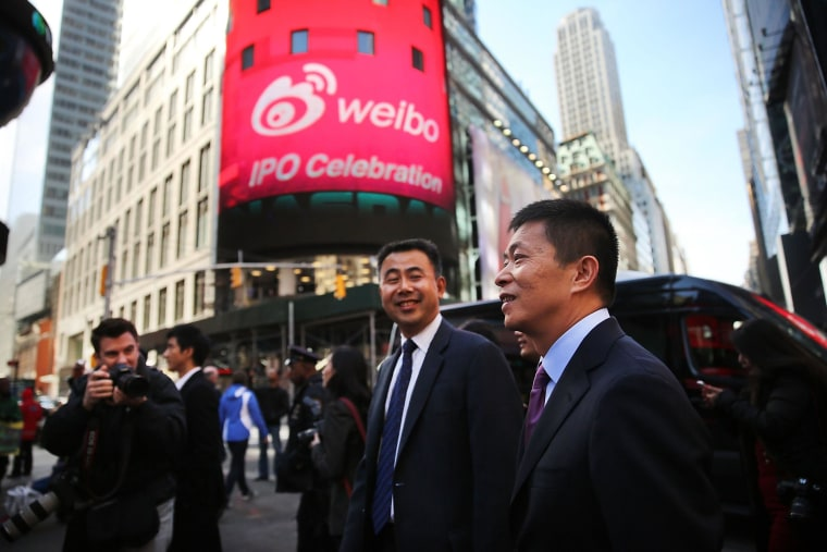 China's Weibo CEO Charles Chao walks in Times Square moments after Weibo began trading on the Nasdaq exchange under the ticker symbol WB.