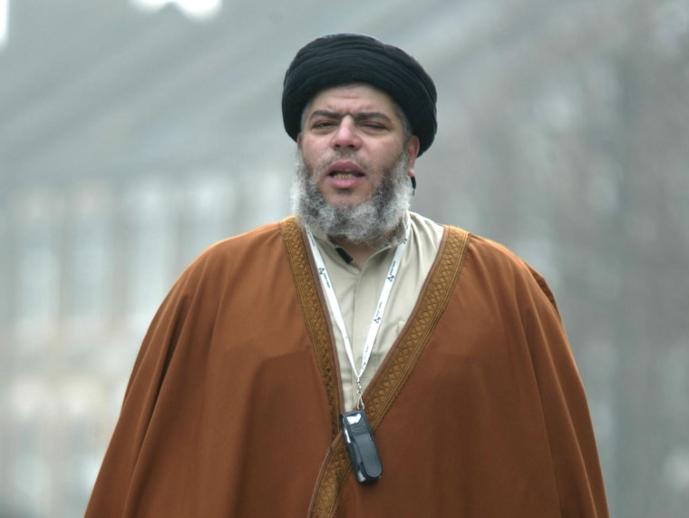 Radical Muslim cleric Mustafa Kamel Mustafa prays in a street outside his Mosque in north London on March 28, 2003.