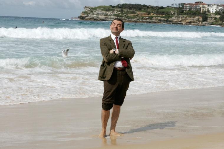 Image: British actor Rowan Atkinson plays his character Mr. Bean on an Australian beach on March 7, 2007.