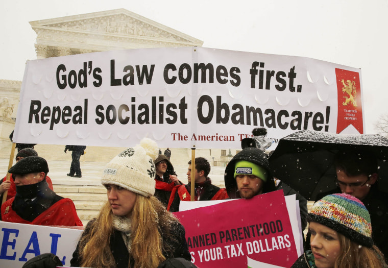 Image: Protesters rally at the steps of the Supreme Court in Washington as arguments begin today to challenge a part of the Affordable Care Act in Washington