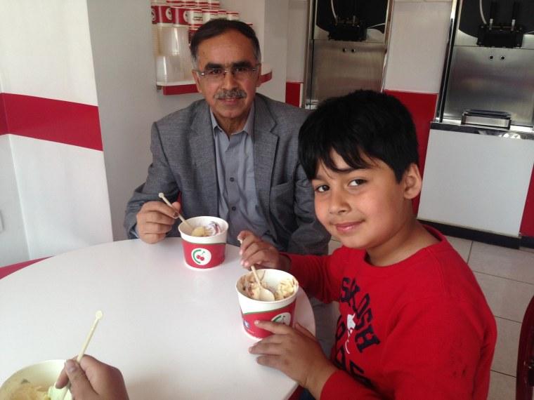 Dr. Esmatullah Nasiri enjoys a frozen yogurt with his grandson at CherryBerry in Kabul, Afghanistan on April 18, 2014.