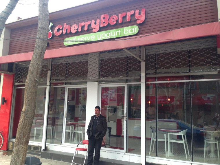 CherryBerry in Kabul is so popular that an unarmed bouncer of sorts stands outside on April 18, 2014 to provide security. Kabul's one and only frozen yogurt outlet was quiet during prayer time on Friday afternoon, but the owners said they anticipated big crowds once prayers were over.