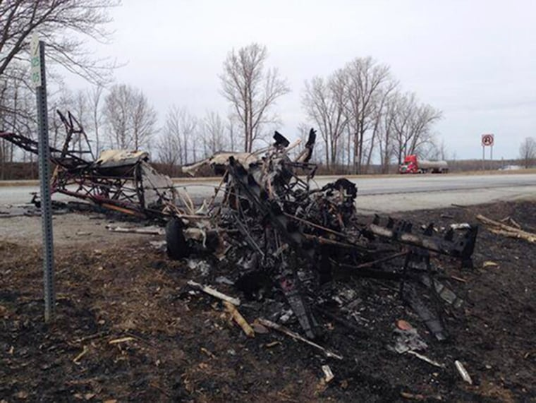 Image: An aerobatic stunt pilot narrowly escaped by parachute when his plane crashed in northern Vermont