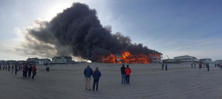 Image: At least three houses were destroyed after a fire broke our near the beach front in Sea Isle City, N.J., on Friday.