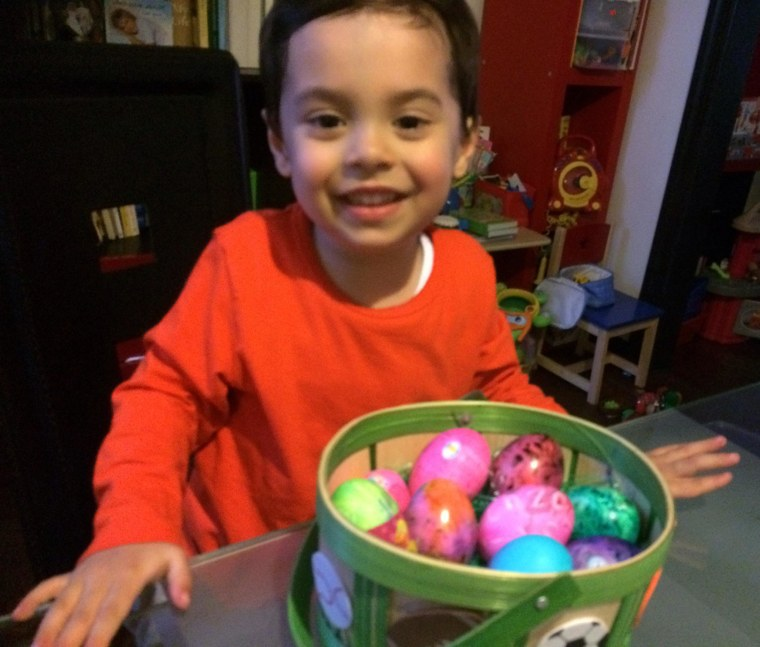 Image: Diana Limongi's son Enzo coloring eggs for the Easter holiday