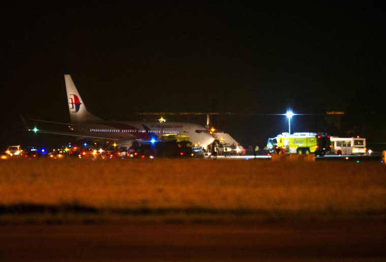 Image: Malaysia Airline flight MH192 is seen on the tarmac after an emergency landing at the Sepang International Airport, outside Kuala Lumpur