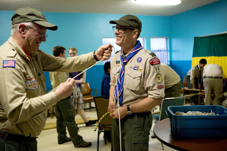 Scoutmaster Geoff McGrath, right, teaches knot tying to Troop Committee Member Donovan O'Brien at a troop meeting at Rainier Beach United Methodist Church in Seattle, Wash. on March 27.