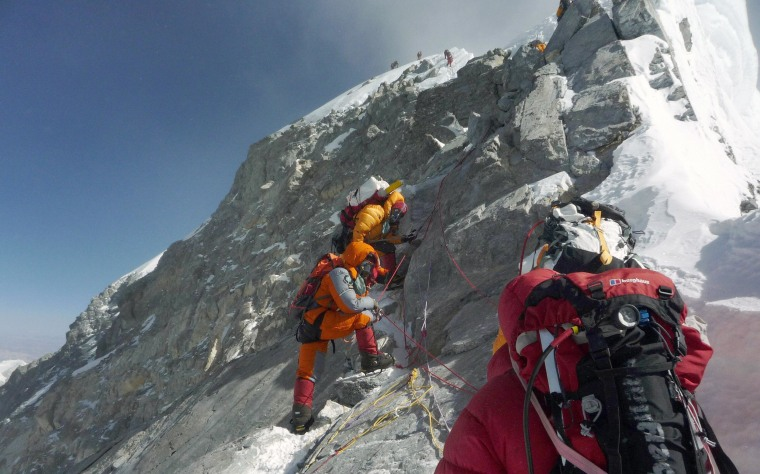 Mountaineers walk past the Hillary Step while pushing for the summit of Everest from the south face of Nepal.