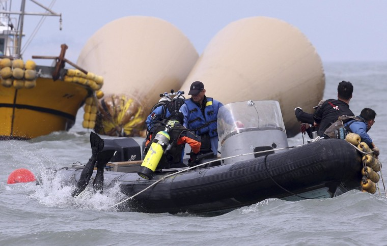 Image: Rescue team drivers prepare to search for ferry passengers on Monday