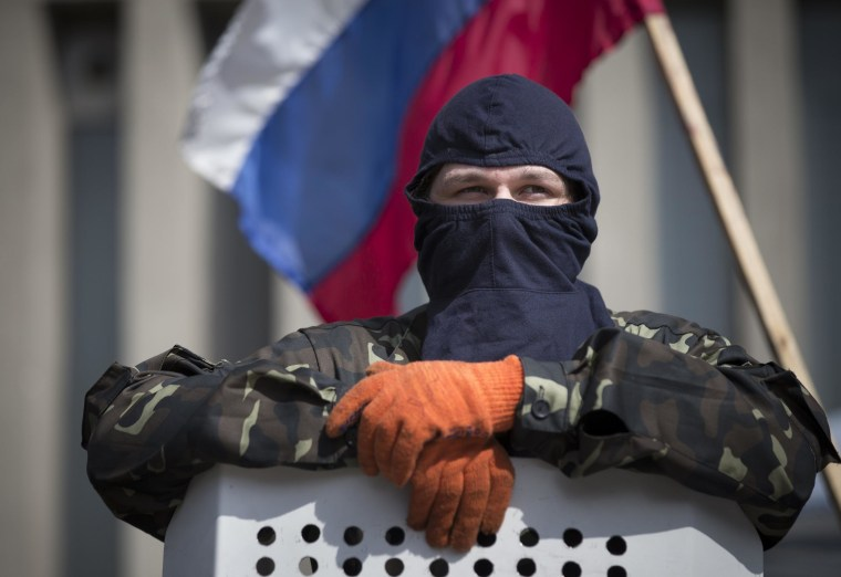 Image: Masked pro-Russian protester in Luhansk, Ukraine