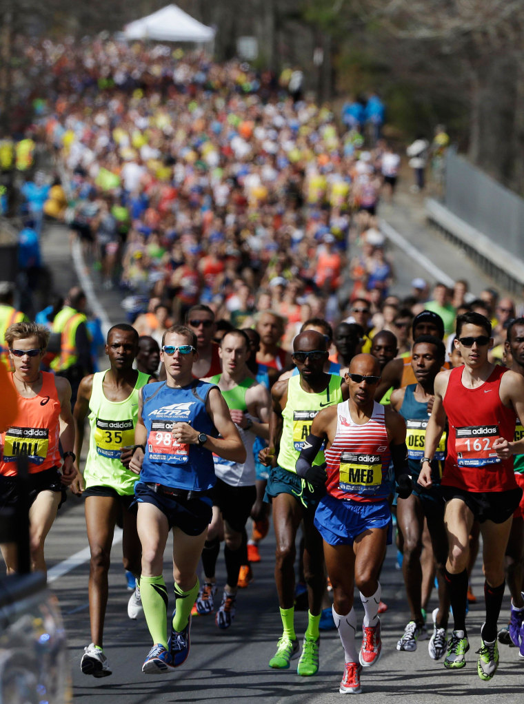 Image: The elite men's runners compete near the start of the 118th Boston Marathon on Monday