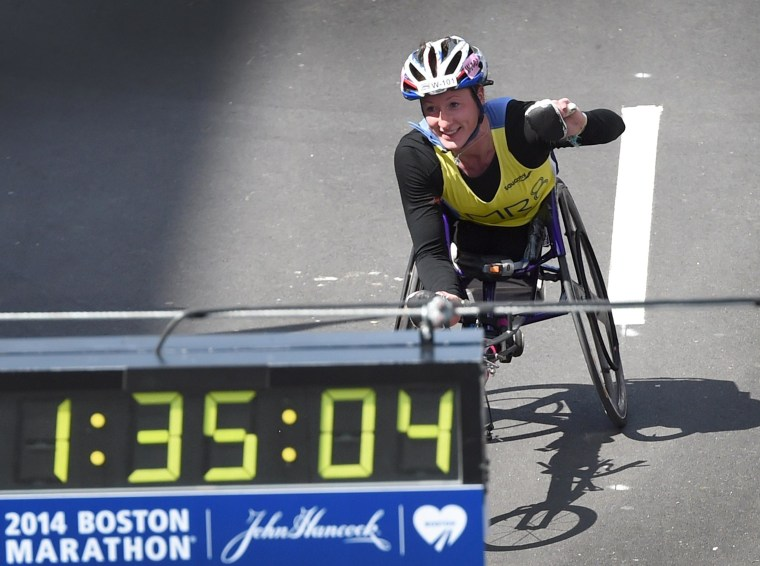 Image: Tatyana McFadden of the U.S., comes down Boylston Street on her way to winning the Women's Push Rim Wheelchair division