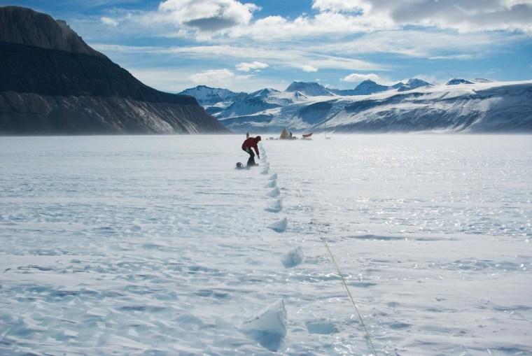 Image: Field glaciologist Daniel Baggenstos collects samples on Taylor Glacier in Antarctica