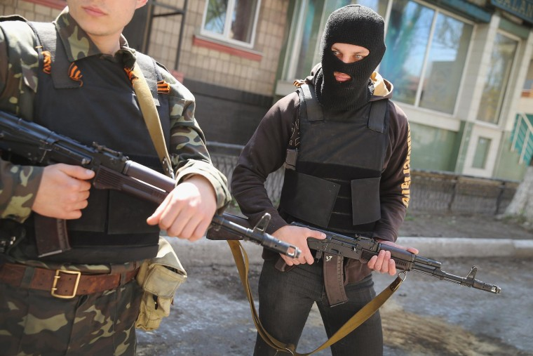 Image: Pro-Russian militant stand guard in front of the occupied Ukraine Security Service building