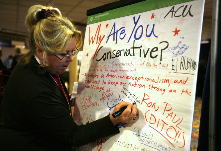 "A woman signs a ""Why are you a Conservative"" message board at the Conservative Political Action conference (CPAC) in Washington February 10, 2011."