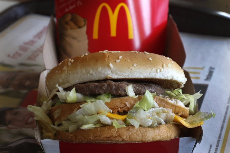 McDonald's posted a lower quarterly profit on Tuesday as high beef costs bit into margins and fewer customer visits resulted in a bigger-than-expected decline in sales.