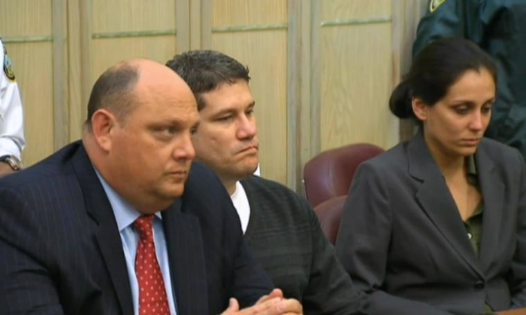 Image: Michel Escoto, center, of South Florida, was found guilty of first-degree murder in the killing of wife Wendy Trapaga in October 2002 to collect a $1 million insurance policy