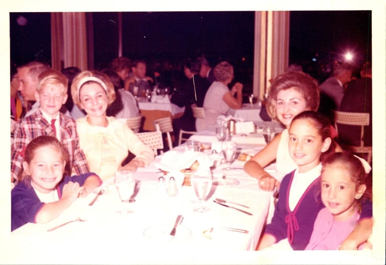 A happy Lisa Ginsburg (lower left) is ready for a family dinner high above New York in the iconic towers at the New York State Pavilion.