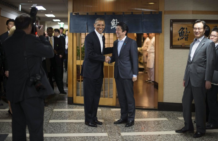Image: President Barack Obama shakes hands with Japanese Prime Minister Shinzo Abe before a private dinner