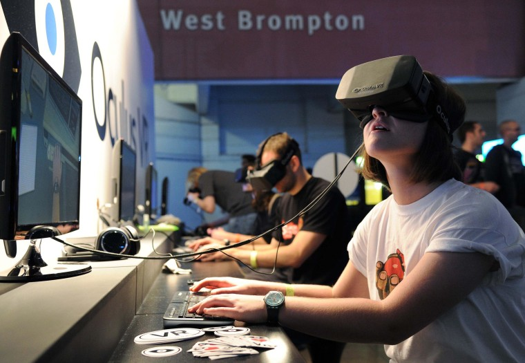 Gamer using the Oculus Rift, a 1080p HD Virtual Reality Headset for 3D Gaming, in Earls Court, London, on Sep. 26, 2013.