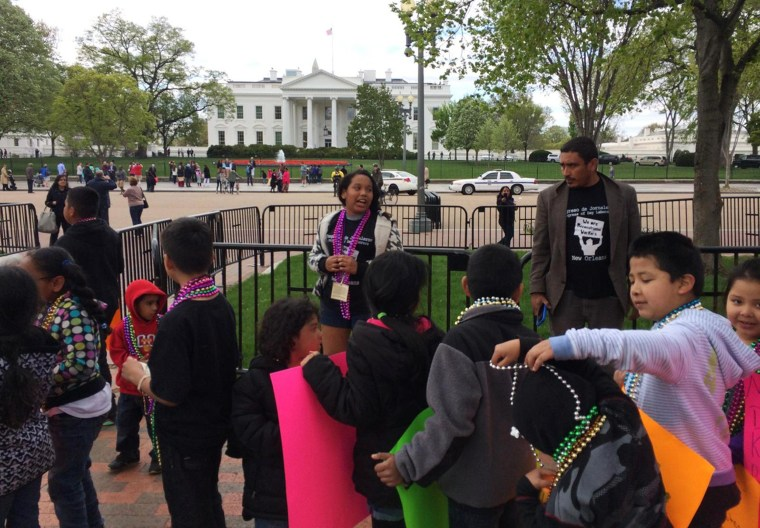 Image: Children participate in a protest at the White House demanding the return to the U.S. of immigrant parents who have been deported from the country on Wednesday April 23, 2014.