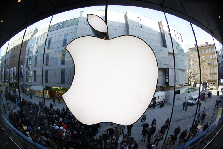 Apple announced a 7-for-1 stock split and quarterly profit and revenue beat Wall Street estimates on Wednesday.
