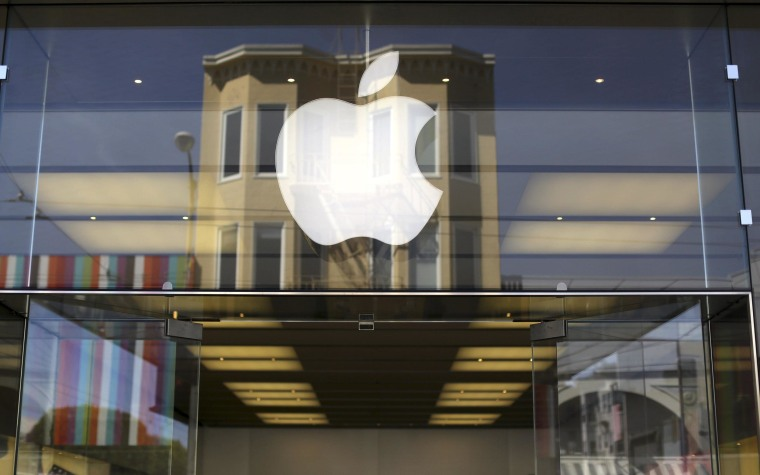 Apple's profit beat expectations on Wednesday and the company announced a 7-for-1 stock split and a dividend increase.